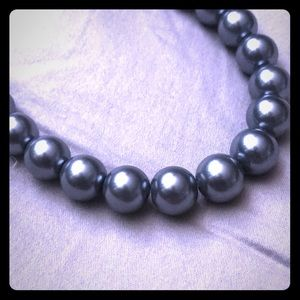 A 19inch string of faux grey pearls.